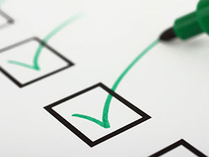 Close up of a checklist with green checkmarks
