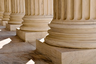 Close up of marble pillars outside of a courthouse