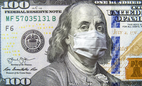 Picture of a one hundred dollar bill with a mask over Benjamin Franklin