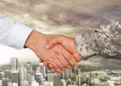Close up of a man shaking a veterans hand